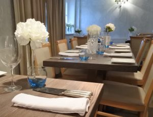 Wood and white flowers complement the duck egg blue walls